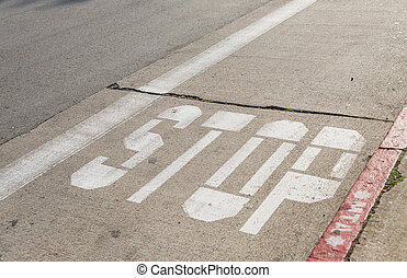 Bus stop sign on the street