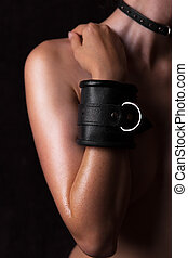 naked body with black leather handcuffs - a beautiful naked...