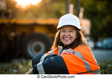 Happy in work - senior woman engineer - Senior woman...