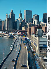Manhattan financial district with skyscrapers and highway...