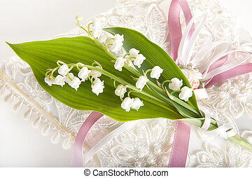Lillies on wedding pillow