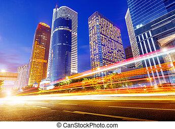 China Guangzhou city night - light trails on the street at...