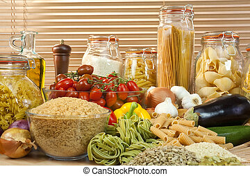 A display of healthy foods including various vegetables,...
