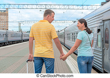 young married couple embarks on a journey on the train