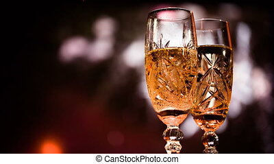 Two glasses with champagne against salute and bengal light....