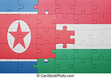 puzzle with the national flag of north korea and hungary...