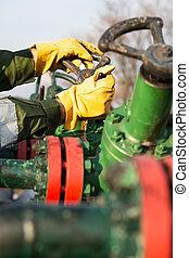 Oil worker turning valve