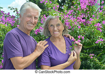 Senior couple in summer park - Portrait of beautiful senior...