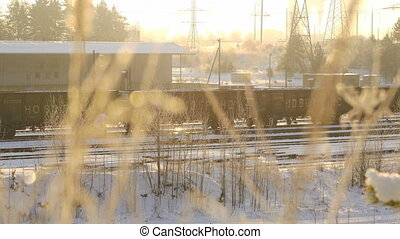 View of moving train in train station depot. Winter nature