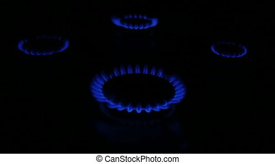 Natural gas inflammation in stove burner 4 flames