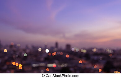 Blurred city lights bokeh - Blurred skyscrapers with city...