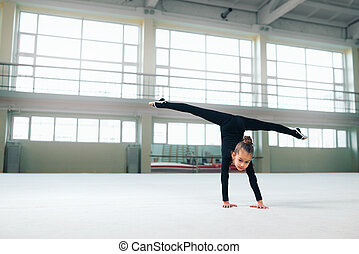 little gymnast standing on hand doing splits - little...