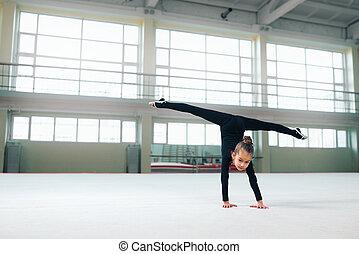little gymnast standing on hand doing splits - little...