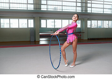 girl in a pink suit athlete proudly stands - Cheerful girl...