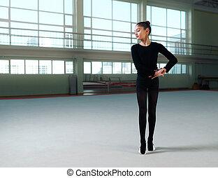 beautiful gymnast in hall of rhythmic gymnastics - beautiful...