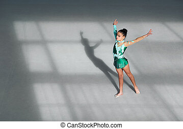 gymnast is in initial position, hands to the side - The...