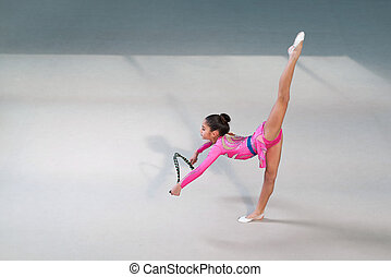 gymnast in suit doing exercises with skipping rope - gymnast...