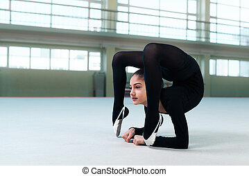 gymnast performs a back bend on floor - gymnast performs a...