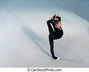 beautiful girl in a black suit makes the balance - beautiful...
