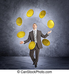 Businessman juggling big coins