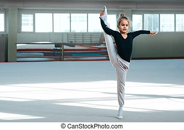 girl doing stretching in gymnastics - girl doing stretching...