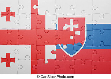 puzzle with the national flag of slovakia and georgia...