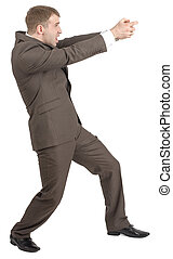Businessman holding invisible gun - Businessman with open...
