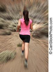 Running - woman runner in motion zoom blur for speed effect....