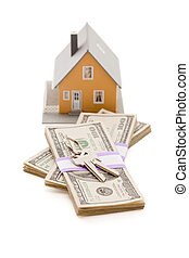 Home and House Keys on Stack of Money Isolated on a White...