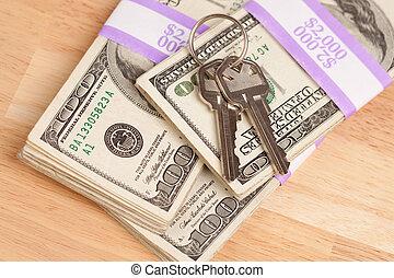House Keys on Stack of Money - Cash for Keys Program.