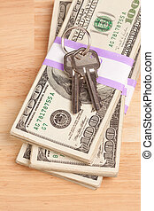 House Keys on Stack of Money - Cash for Keys Program.