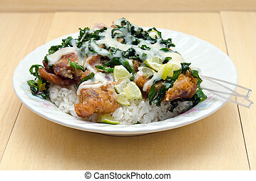 Fried chicken with lemon sauce and herb over rice famous...