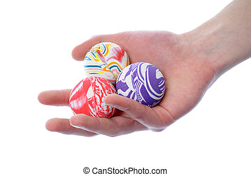 Bouncy balls - Hand holding a set of round bouncy rubber...