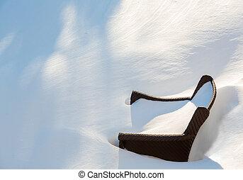 Outdoors garden chair buried in snow drift - Outdoor garden...