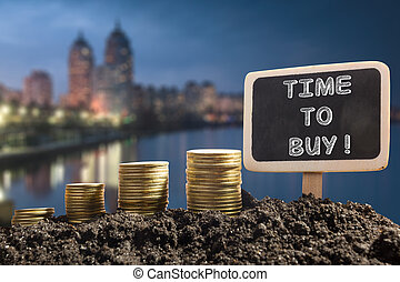Time to buy - Financial opportunity concept. Golden coins in...