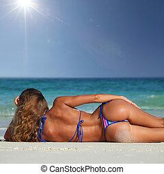 Woman on tropical beach - Rear view of sexy woman in bikni...