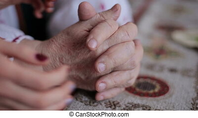 Old and young hands. Hands of the old woman - 95 years...