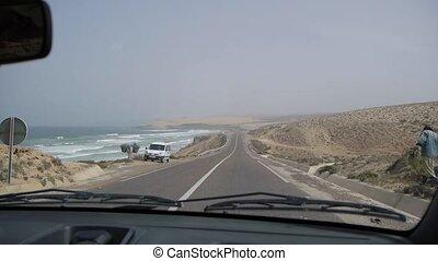 pov driving near the coastline of ocean, Morocco