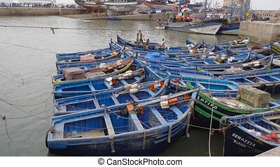 Blue boats in the harbor of Essaouira, Morocco The old...