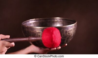 Singing bowl close-up - Tibetan singing bowl in female hands...