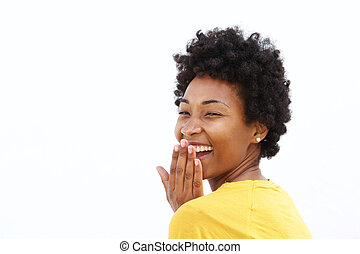 Young woman covering her mouth and laughing