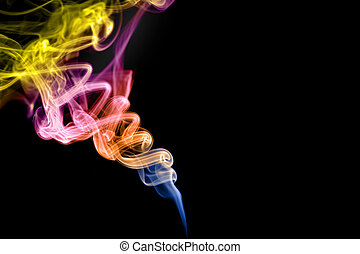 smoke over black - rainbow colored smoke streaming up and...