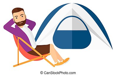 Man sitting in folding chair - A hipster man with the beard...