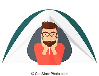 Man lying in tent - A hipster man with the beard crawling...