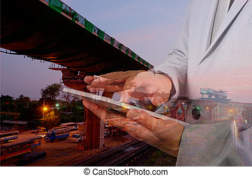 Double exposure of Engineer Man use Mobile Tablet with...