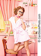 retro pink - Sexy pin-up girl wearing pink bathrobe alluring...