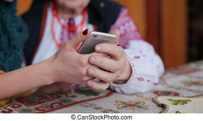 Granddaughter in using smartphone - Granddaughter assisting...