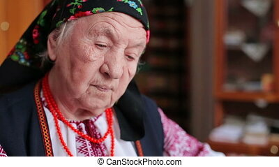 Grandmother in embroidery Ukrainian national clothes HD