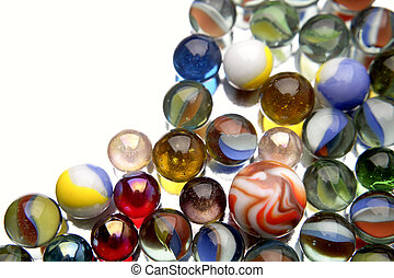 Marbles - Close-up of glass marbles on white