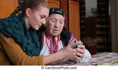 Granddaughter in using smartphone - Granddaughter and...